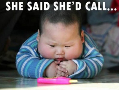 Child waiting for the phone to ring - she said she'd call...