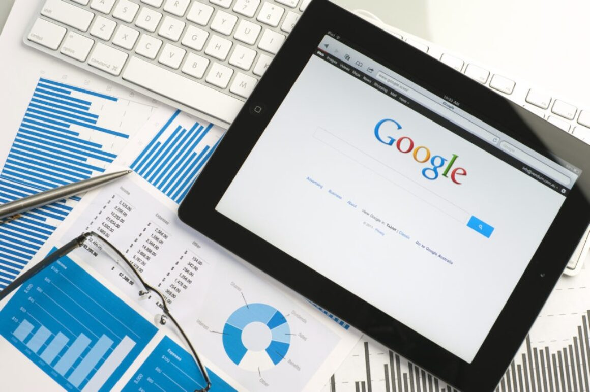 tablet-displaying-google-search-screen-on-loose-papers-with-business-analytics