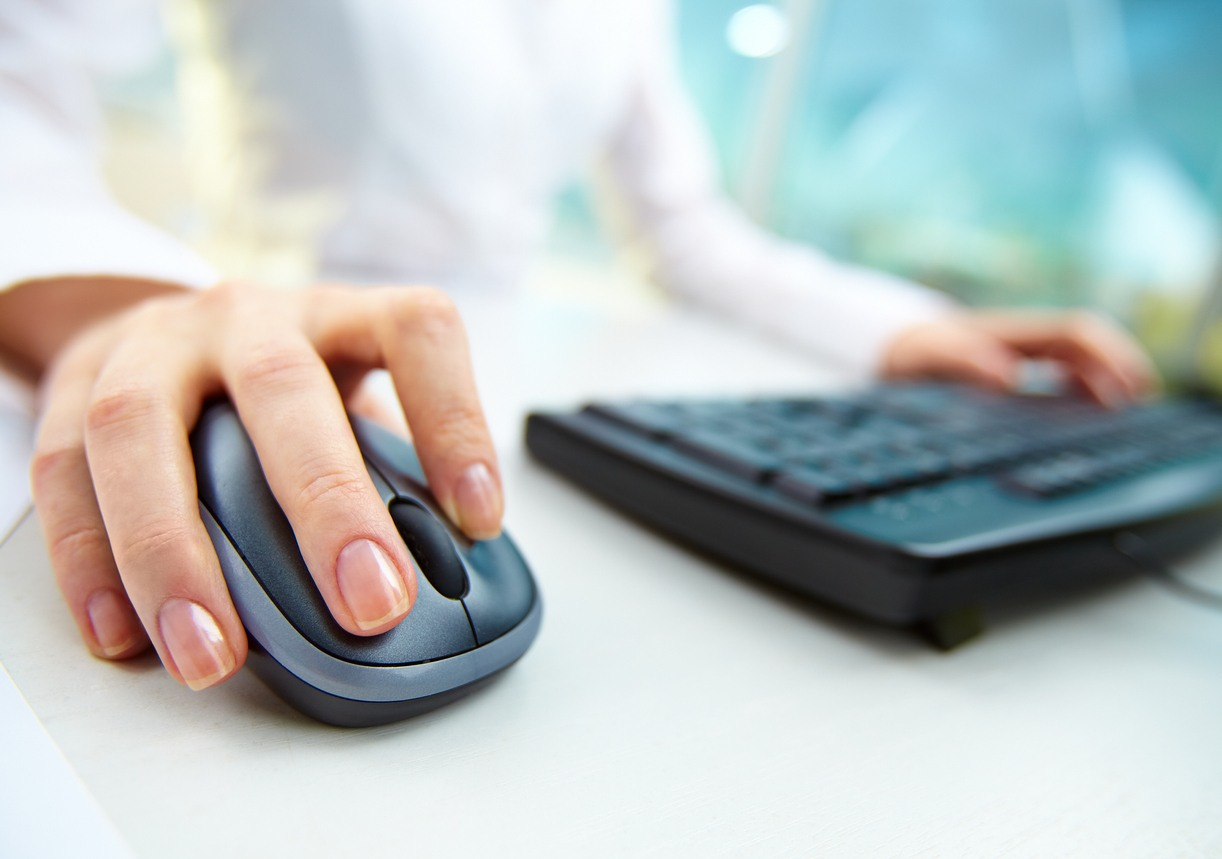 Image of female hands clicking computer mouse pay per click PPC concept