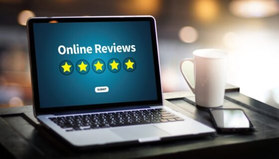 5 star online reviews on a laptop.