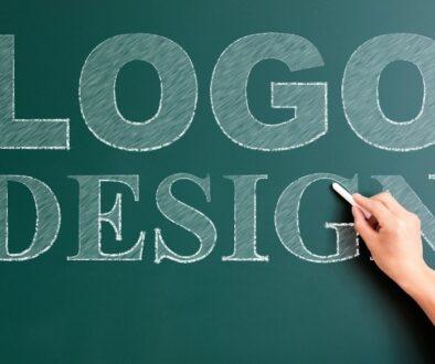 Words logo design writen in white chalk on green chalkboard.