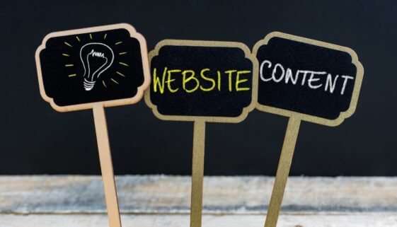 Small chalkboards with lightbulb website content written on them